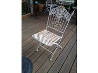 Wrought Iron Table and 4 Chairs needs a little TLC.