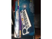 Yamaha keyboard psr 160 excellent condition in original box with charger and music stand