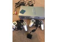 Playstation 2 (silver) with Buzz Game