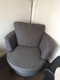 Two grey swivel chairs