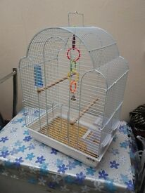 A white bird cage for sale with bird food good condition need gone asap
