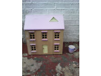 Two childrens dolls houses with assorted wooden furniture.