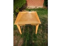 Beautiful tan in color square side table. Very strong and durable