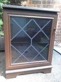 Wooden cabinet with glass front, good condition
