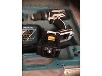 Makita used hammer drill comes with battery and charger