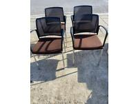 4 brown chairs