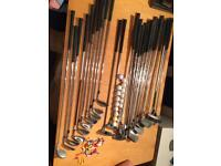 Various left and right handed golf clubs
