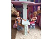 Barbie doll house. Very good condition. Comes with 5 dressed barbie dolls.