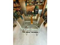 Magnificent glass table and 4 dining chairs in light grey Italian leather for sale