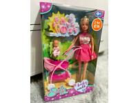 Brand new doll with baby and accessories