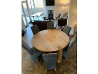 Solid oak circular table and chairs