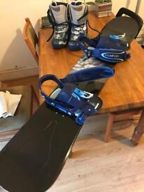 Snowboard with boots and carry bag