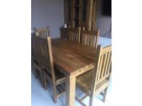 Table and six chairs with dresser. Solid wood