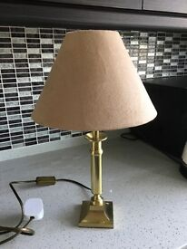 Two brass lamps