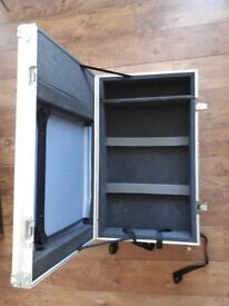 Sturdy flight case with wheels and handles