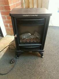 Small free standing electric fire.