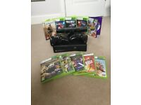 XBOX 360 console with two controllers and 10 games inc lego movie, call of duty and FIFA