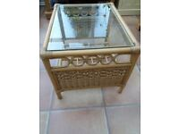 Cane glass topped table.66x52cms,very good condition.