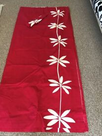 Pair or red curtains with tiebacks