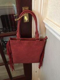 Ladies pink Handbag with frills. Fairly big inside with pockets