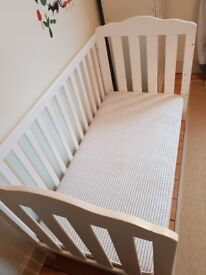 Wooden cot bed with mattress.