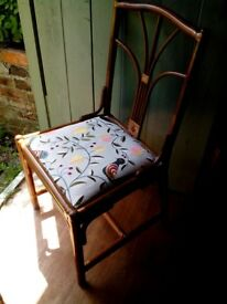 Bamboo chair with delightful embroidered cover