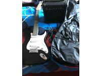 Electric guitar Amplifier. Guitar lead And case.