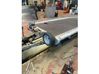 Brian James pump and tilt 18ft bed tri axle transporter trailer