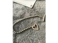 Gucci silver heart t bar bracelet