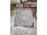 old used cast iron drain inspection/manhole cover