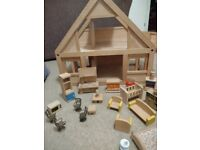 Adorable dolls house with loads of furniture and fittings