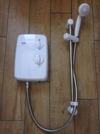 Triton Riba electric shower unit all complete, only 7 months old. Still in warranty period.