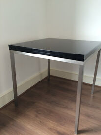 'Dwell' 4 to an 8 seater dining table expanding dining table with chrome legs.