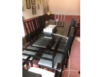 Black based/ glass topped dining table & 10 chairs.