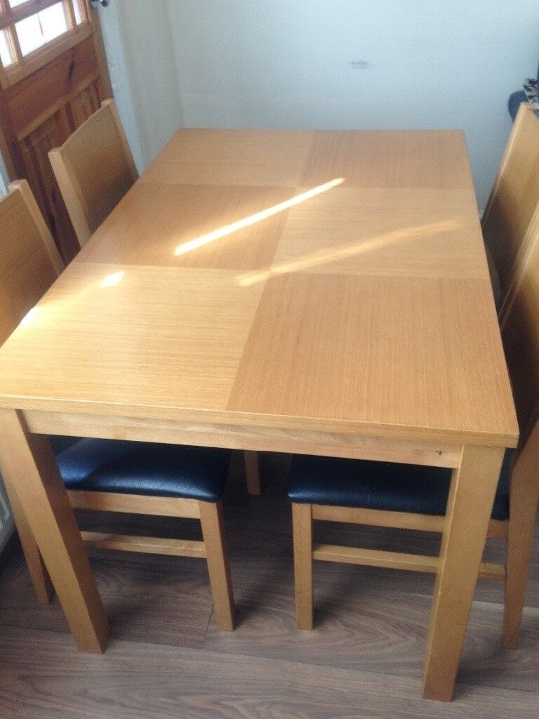***VERY GOOD CONDITION WOODEN DINING TABLE N CHAIRS***