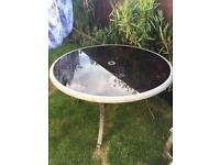 Round garden table and 4 swivel chairs