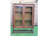 Antique oak bookcase cabinet with barley twist legs