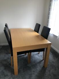 Oak dinning table and 4 leather chairs