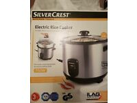 Brand new rice cooker, can also steam vegetables