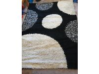 Beautiful black and white rug. Really nice and in good condition.