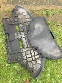 Audi a4 under engine trays.