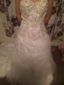 Beautiful dress size 8-10, will need a underskirt, there is some wear but not noticeable