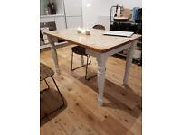 Rustic wooden dining table - painted legs