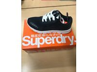 Brand new men's Superdry Scuba Trainers. size 7. Spare navy laces included. Never worn