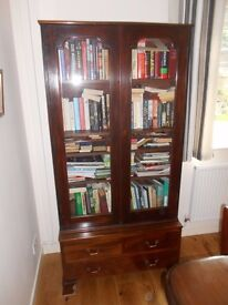 Antique glass fronted bookcase on 3 drawer chest.