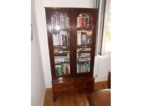 Antique 2 door glass fronted bookcase on 3 drawer chest.