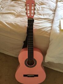 Pink classic guitar and wall hanger