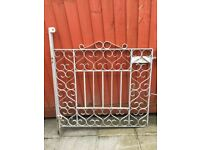 Iron driveway gates with scrolling