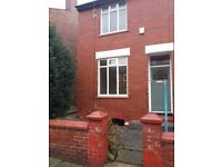 Large 2 bed centrally heated house in Cheadle Heath. Double rooms, large garden and great location.