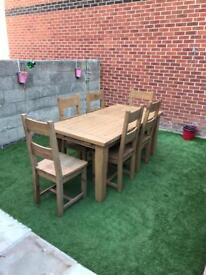 Oak extendable table 8/10 seater with six chairs (£1275 new)